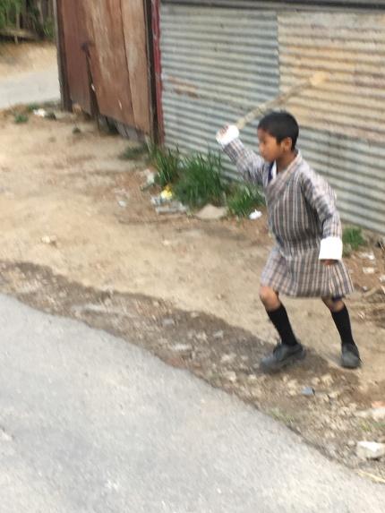 Kid playing in Thimphu